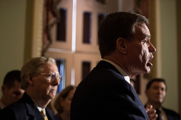 UNITED STATES - MAY 19: Sen. Mark Warner, D-Va., right, speaks during the news conference with Senate Majority Leader Mitch McConnell, R-Ky., left, in the Ohio Clock Corridor with small business owners from Ohio, Wisconsin and Kentucky to discuss trade on Tuesday, May 19, 2015. (Photo By Bill Clark/CQ Roll Call)
