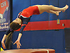 Gillian Drexler of Cold Spring Harbor springs from the vault during the eight-team Cartwheel for a Cure gymnastics meet at Cold Spring Harbor High School on Monday, Jan. 16, 2017.