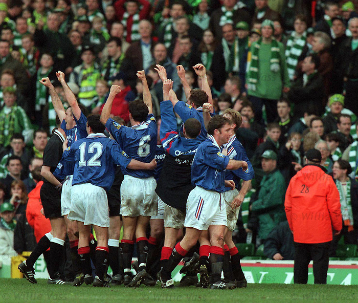 Rangers celebrate victory at Celtic Park by imitating the Celtic huddle in front of their support. March 16th 1997