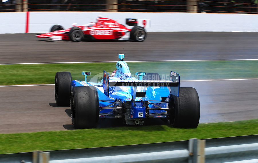 May 25, 2008; Indianapolis, IN, USA; IRL driver Sarah Fisher spins as Scott Dixon (9) passes during the 92nd running of the Indianapolis 500 at the Indianapolis Motor Speedway. Mandatory Credit: Mark J. Rebilas-