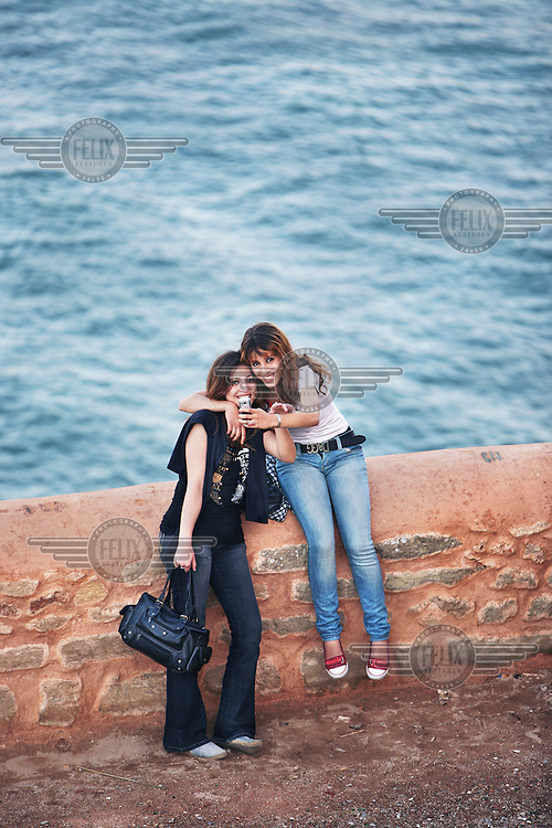 Girls taking a picture of themselves at the Kasbah in Rabat, that overlooks the Atlantic Ocean.
