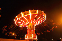 An exciting ride at the 50th State Fair at night on O'ahu