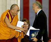 Washington, DC - October 17, 2007 -- The 14th Dalai Lama, Tenzin Gyatso, left, shakes hands with Nobel Laureate Elie Wiesel, right, in Washington, D.C. on Wednesday, October 17, 2007.  The Dalai Lama was at The Capitol to accept the Congressional Gold Medal, the nation's highest and most distinguished civilian award.  Speaker of the House Nancy Pelosi (Democrat of California) looks on from lower center..Credit: Ron Sachs/CNP