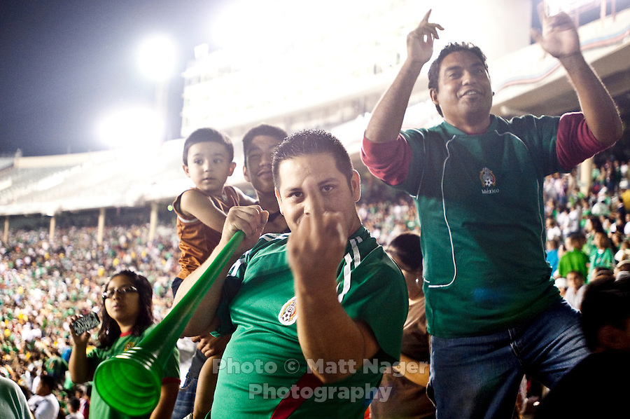 Mexico fans yell and curse at Colombia fans in an exhibition game at the Cotton Bowl in Dallas, Texas, USA, Wednesday, Sept., 30, 2009. Colombia won the game 2-1, which was played as the second game of a double header after an FC Dallas soccer game in an attempt by Major League Soccer to draw a new crowd of hispanic people to the sport in the US...PHOTOS/ MATT NAGER