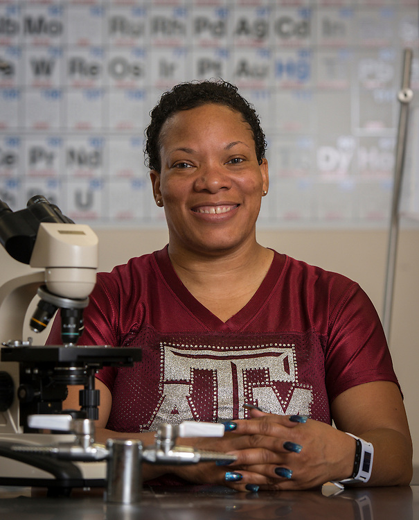 Wheatley High School biology teacher Ferleshare Starks poses for a photograph in her classroom, August 14, 2015.