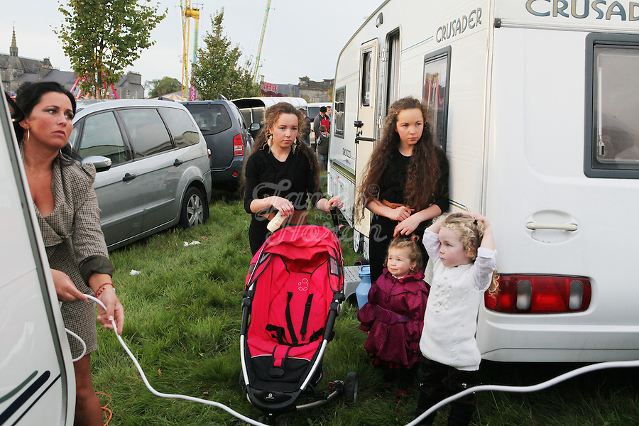 2/10/2010. Traveler Maria Stokes is pictured geting electricity to her caravan at the Ballinasloe Horse Fair, Ballinasloe County Galway, Ireland. Picture James Horan