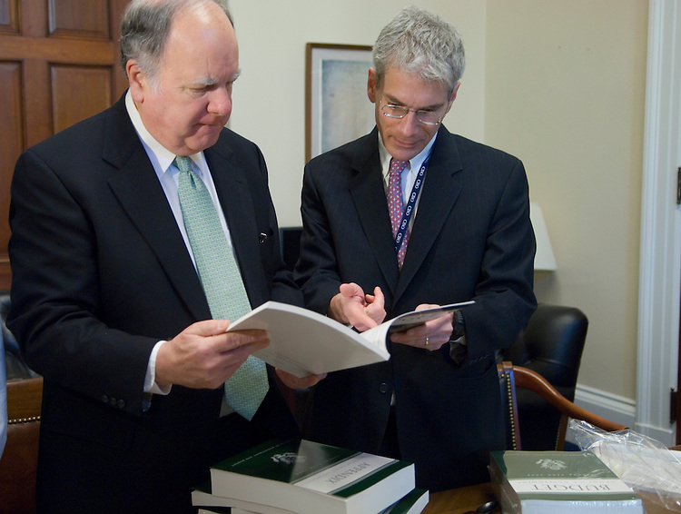 House Budget Chairman John Spratt, D-S.C. and Staff Director and Chief Counsel Thomas S. Kahn take a quick look at the FY2008 budget  in Spratt's office.