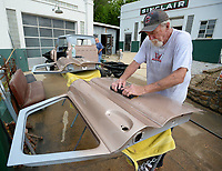 Clem Johnson, owner of Tuba Trucks in Fayetteville, wet-sands the door of a 1965 Chevrolet C10 pickup that his company is restoring for a customer. Johnson's company provides restoration and mechanical work for classic cars and trucks. Visit nwaonline.com/200627Daily/ for today's photo gallery.<br /> (NWA Democrat-Gazette/Andy Shupe)