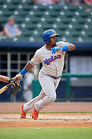 Midland RockHounds left fielder B.J. Boyd (9) follows through on a swing during a game against the Northwest Arkansas Naturals on May 27, 2017 at Arvest Ballpark in Springdale, Arkansas.  NW Arkansas defeated Midland 3-2.  (Mike Janes/Four Seam Images)