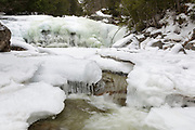 Iced over cascades on the Swift River in Livermore, New Hampshire during the winter months.