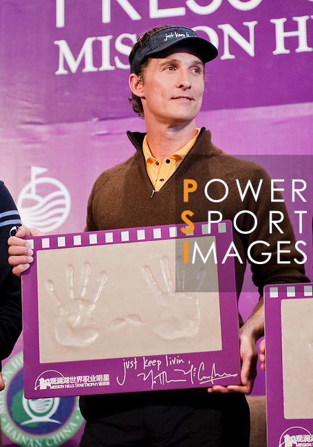 HAIKOU, CHINA - OCTOBER 28:  Hollywood actor Matthew McConaughey poses with his handprints during a press conference as part of the Mission Hills Star Trophy on October 28, 2010 in Haikou, China. The Mission Hills Star Trophy is Asia's leading leisure liflestyle event and features Hollywood celebrities and international golf stars. Photo by Victor Fraile / The Power of Sport Images