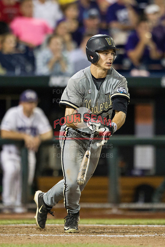 Vanderbilt Commodores second baseman Tyler Campbell (2) follows through on his swing during the NCAA College baseball World Series against the TCU Horned Frogs on June 16, 2015 at TD Ameritrade Park in Omaha, Nebraska. Vanderbilt defeated TCU 1-0. (Andrew Woolley/Four Seam Images)