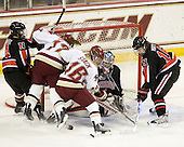 Maggie DiMasi (NU - 4), Danielle Welch (BC - 17), Kelli Stack (BC - 16), Leah Sulyma (NU - 1), Julia Marty (NU - 16) - The Boston College Eagles defeated the visiting Northeastern University Huskies 2-1 on Sunday, January 30, 2011, at Conte Forum in Chestnut Hill, Massachusetts.