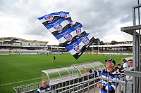 A Bath fan waves a giant flag prior to the match. West Country Challenge Cup match, between Gloucester Rugby and Bath Rugby on September 13, 2015 at the Memorial Stadium in Bristol, England. Photo by: Patrick Khachfe / Onside Images