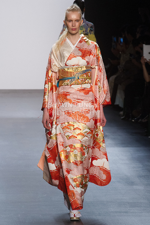 "Model walks runway in a ""Dawn"" silk kimono from the Hiromi Asai Fall Winter 2016 ""Spirit of the Earth"" collection by Hiromi Asai & Kimono Artisan Kyoto, presented at NYFW: The Shows Fall 2016, during New York Fashion Week Fall 2016."