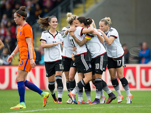 25.10.2016. Aeln, Germany.  Germany's Sara Daebritz, Tabea Kemme, goal-scorer Anja Mittag, Dzsenifer Marozsan, Isabel Kerschowski celebrate the goal for 3-1 during the women's international football match between Germany and the Netherlands in the Scholz Arena in Aalen, Germany, 25 October 2016.