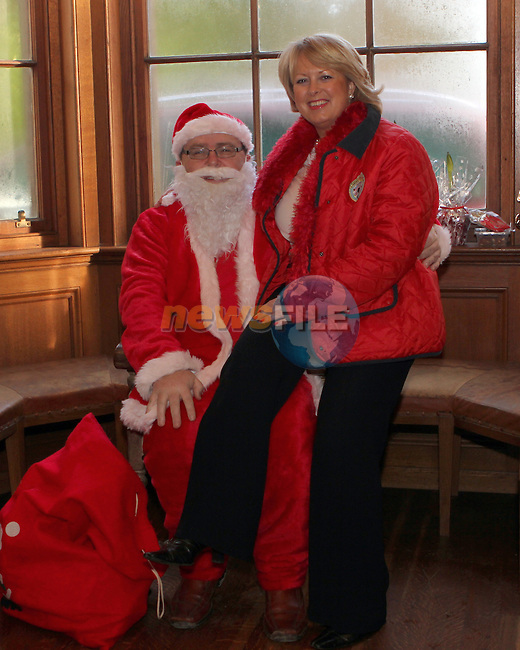 Michelle Reddan with Santa at the St.Peter's Christmas Fair in Beaulieu House...Photo NEWSFILE/Jenny Matthews..(Photo credit should read Jenny Matthews/NEWSFILE)