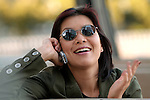 Asian woman, talking on cell phone, smiling
