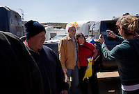 """Searchlight, Nevada, March 28, 2010 - Speaker Joe """"The Plumber"""" Wurzelbacher takes pictures with fans during the first Tea Party Express rally in Searchlight, the hometown of Senate Majority Leader Harry Reid. Dubbed the Showdown in Searchlight, the event is located just north of town on private property near Reid's home. The raucous, but peaceful event was expected to draw 5,000 to 10,000 supporters, with actual estimates ranging from 7,000 to 8,000 - though party organizers said the numbers were as high as 13,000. The 20-day tour will wind through the United States ending up in Washington, D.C. on April 15 for a tax day rally. ."""