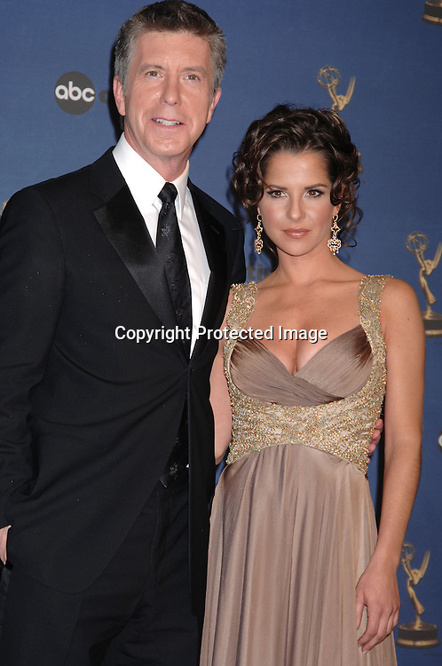 The Hosts of the Show Tom Bergeron and Kelly Monaco..in the Press Room  at the 33rd Annual Daytime Emmy Awards on April 28, 2006 at The Kodak Theatre in Hollywood, Californina. ..Robin Platzer, Twin Images