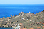 Coastal landscape Cabo de Gata natural park, looking west to the lighthouse, Almeria, Spain