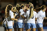 13 November 2015: North Carolina's Jessie Scarpa (12) is mobbed by teammates after scoring the game's opening goal. The University of North Carolina Tar Heels hosted the Liberty University Flames at Fetzer Field in Chapel Hill, NC in a 2015 NCAA Division I Women's Soccer game. UNC won the game 3-0.