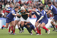 South African loose head Corne Fourie drives play forward during the first half of the Division A clash against France at Ravenhill.