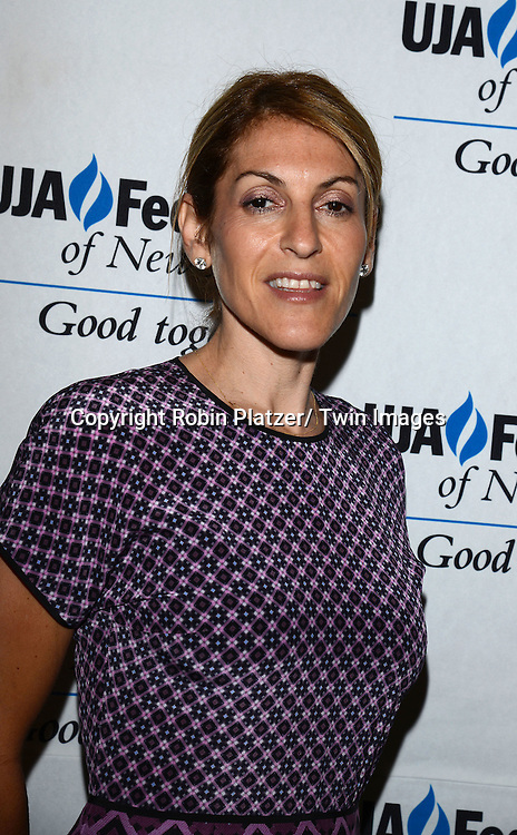 Julie Greenwald  attends the UJA-Federation of New York's Music Visionary of the Year Luncheon on June 25, 2014 at the Pierre Hotel in New York City. Neil Portnow, President/CEO of the Recording Academy was the honoree.