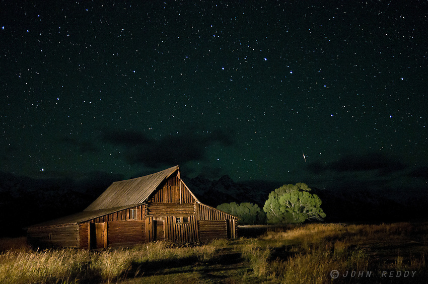 light painting of  historic Moulton barn on Mormon Row with a starry night sky