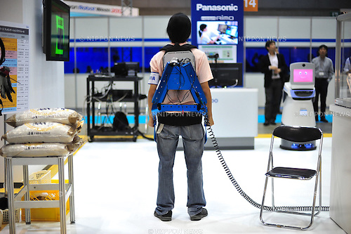 October 17, 2012, Tokyo, Japan - Muscle Suits by Tokyo University of Science are displayed during Japan Robot Week 2012 at the Tokyo Bigsight. It helps people to carry a heavy thing easier. This exhibition is held to showcase new robots and high technology equipments for visitor. Japan Robot Week 2012 runs from October 17 - 19. (Photo by Yumeto Yamazaki/AFLO)