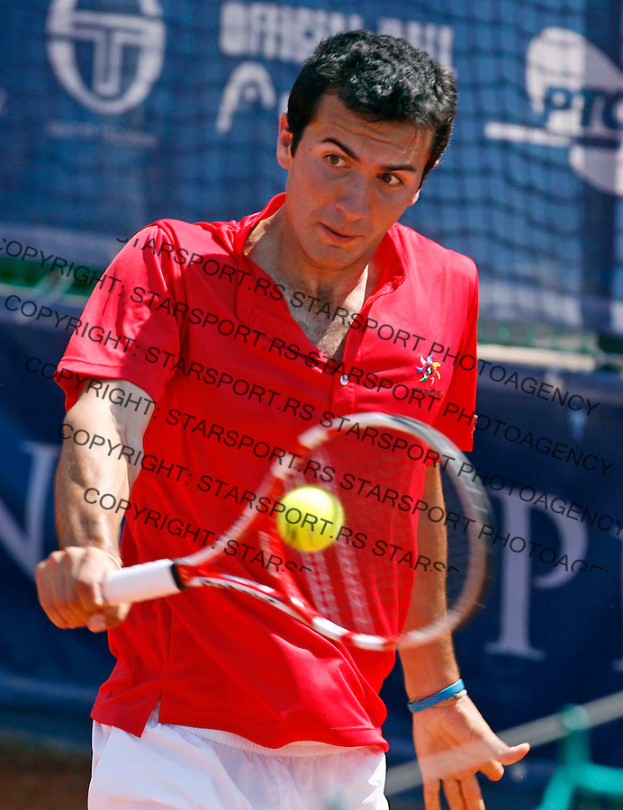 "Gianluca Naso from Italy returns the ball during ATP 250 series tennis tournament ""Serbia Open"" in Belgrade, Serbia, Saturday, April 23. 2011. (credit image & photo: Pedja Milosavljevic / thepedja@gmail.com / +381641260959)"