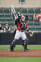Kannapolis Intimidators catcher Brett Austin (20) tracks a pop fly during the game against the Hickory Crawdads at CMC-Northeast Stadium on April 17, 2015 in Kannapolis, North Carolina.  The Crawdads defeated the Intimidators 9-5 in game one of a double-header.  (Brian Westerholt/Four Seam Images)