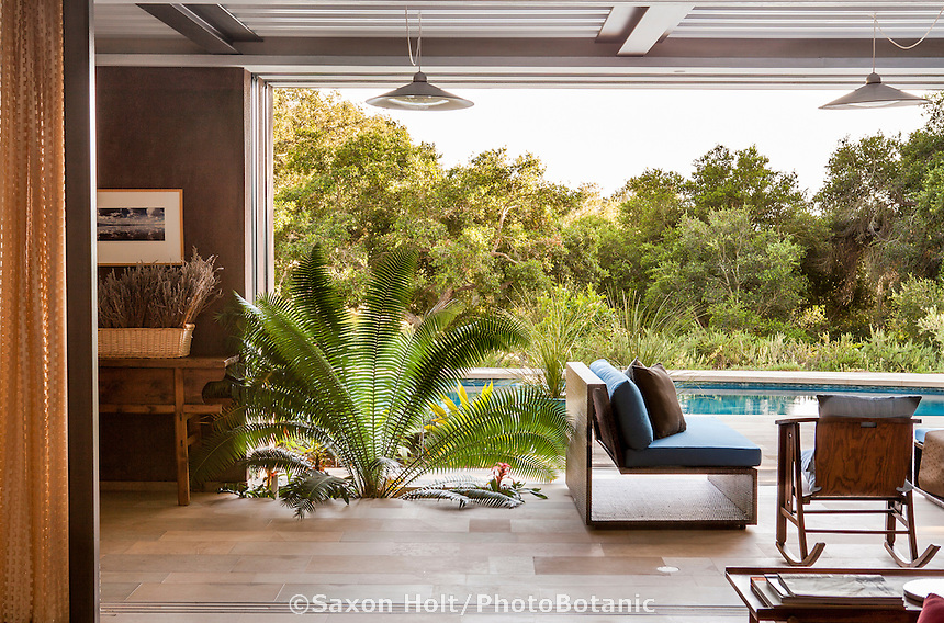Open air living room connected to patio through sliding glass doors; Coyote House, LEED Platinum, SITES® residential home with sustainable garden; Santa Barbara California, Susan Van Atta landscape architect, Ken Radtkey architect,