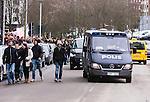 Solna 2015-03-07 Fotboll Allsvenskan AIK - Hammarby IF :  <br /> AIK:s supportrar och en polisbil utanf&ouml;r Friends Arena inf&ouml;r matchen mellan AIK och Hammarby IF <br /> (Foto: Kenta J&ouml;nsson) Nyckelord:  AIK Gnaget Friends Arena Svenska Cupen Cup Derby Hammarby HIF Bajen supporter fans publik supporters polis poliser