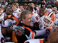 Illinois head coach Vic Koenning celebrates with his players after winning Kraft Bowl against UCLA at AT&T Park in San Francisco, California on December 31st, 2011.   Illinois defeated UCLA, 20-14.