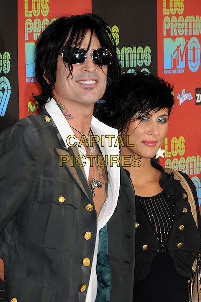 TOMMY LEE & GUEST .MTV Los Premios Awards 2009 held at the Gibson Amphitheatre, Universal City, California, USA, 15th October 2009..half length black soul patch facial hair grey gray jacket white shirt tattoos necklace chest .CAP/ADM/BP.©Byron Purvis/Admedia/Capital Pictures