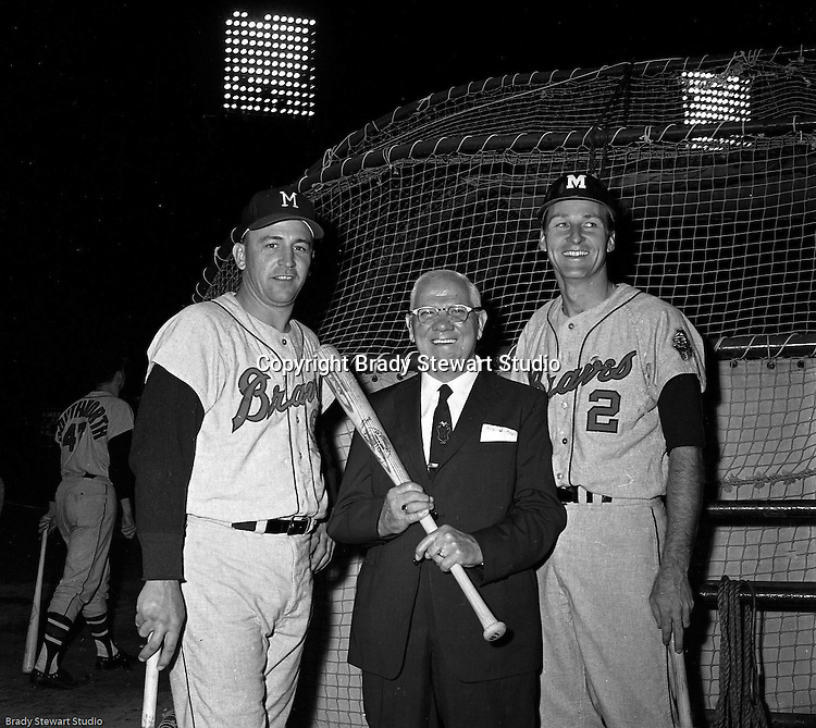 Pittsburgh PA:  View of Frank Thomas and Frank Bolling posing with a sponsor during the annual HYPO charity baseball game at Forbes Field.<br />