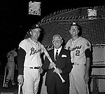 Pittsburgh PA:  View of Frank Thomas and Frank Bolling posing with a sponsor during the annual HYPO charity baseball game at Forbes Field.<br /> The money raised by HYPO (Help Young Players Organize) was used to help local communities buy equipment and build ball fields.