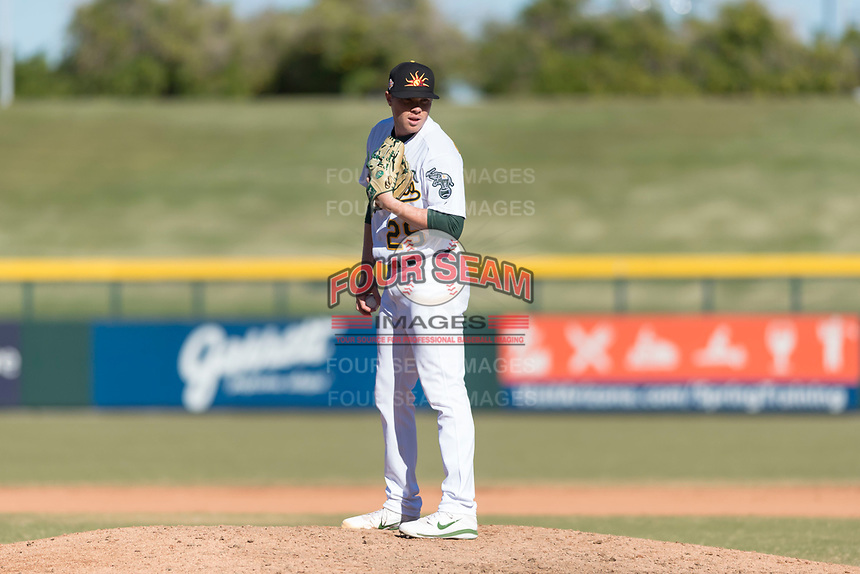 Mesa Solar Sox relief pitcher Sam Sheehan (29), of the Oakland Athletics organization, looks in for the sign during an Arizona Fall League game against the Surprise Saguaros at Sloan Park on November 15, 2018 in Mesa, Arizona. Mesa defeated Surprise 11-10. (Zachary Lucy/Four Seam Images)