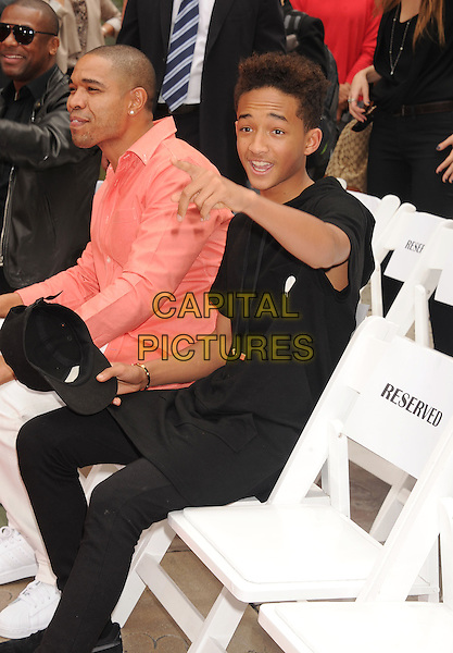 Jaden Smith<br /> at Jackie's Hand and Footprint Cement Ceremony at TCL Chinese Theatre on in Hollywood, California, USA, June 6th 2013. <br /> half  length black hoodie hand pointing mouth open gesture funny sitting <br /> CAP/ROT/TM<br /> &copy;Tony Michaels/Roth Stock/Capital Pictures
