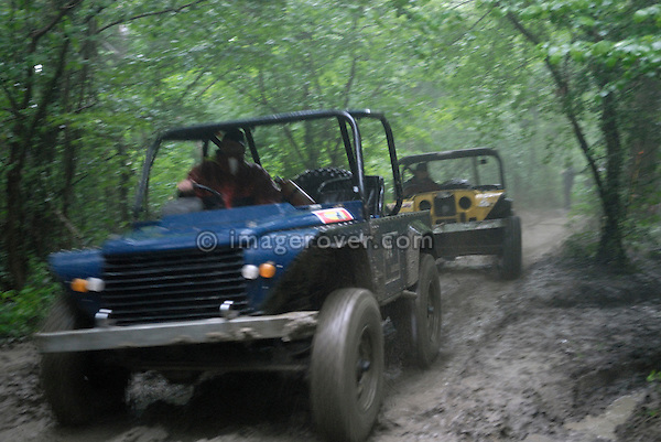 Land Rover based off-road racers competing at the ALRC National 2008 CCVT trial during very bad weather. The Association of Land Rover Clubs (ALRC) National Rallye is the biggest annual motor sport oriented Land Rover event and was hosted 2008 by the Midland Rover Owners Club at Eastnor Castle in Herefordshire, UK, 22 - 27 May 2008. --- No releases available. Automotive trademarks are the property of the trademark holder, authorization may be needed for some uses.