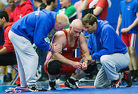 11 MAY 2014 - SHEFFIELD, GBR - Mark Cocker listens to his coaches during one of his 97kg category freestyle matches at the British 2014 Senior Wrestling Championships at EIS in Sheffield, Great Britain (PHOTO COPYRIGHT © 2014 NIGEL FARROW, ALL RIGHTS RESERVED)