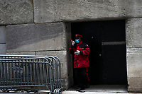 NEW YORK, NY - APRIL 20: A security worker is seen near the New York Stock Exchange on April 20, 2020. in New York City. United States. U.S. President Trump is looking to get many Americans back to work as soon as possible, but also he recognizes that cities like New York will need to go slow. (Photo by Eduardo MunozAlvarez/VIEWpress)