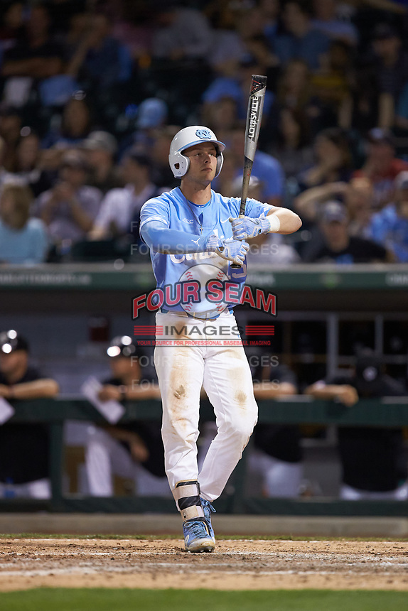 Michael Busch (15) of the North Carolina Tar Heels walks to the play against the South Carolina Gamecocks at BB&T BallPark on April 3, 2018 in Charlotte, North Carolina. The Tar Heels defeated the Gamecocks 11-3. (Brian Westerholt/Four Seam Images)