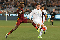 Melbourne, 18 July 2015 - Mapou Yanga-Mbiwa of AS Roma and Cristiano Ronaldo of Real Madrid compete for the ball in game one of the International Champions Cup match at the Melbourne Cricket Ground, Australia. Roma def Real Madrid 7-6 Penalties. Photo Sydney Low/AsteriskImages.com