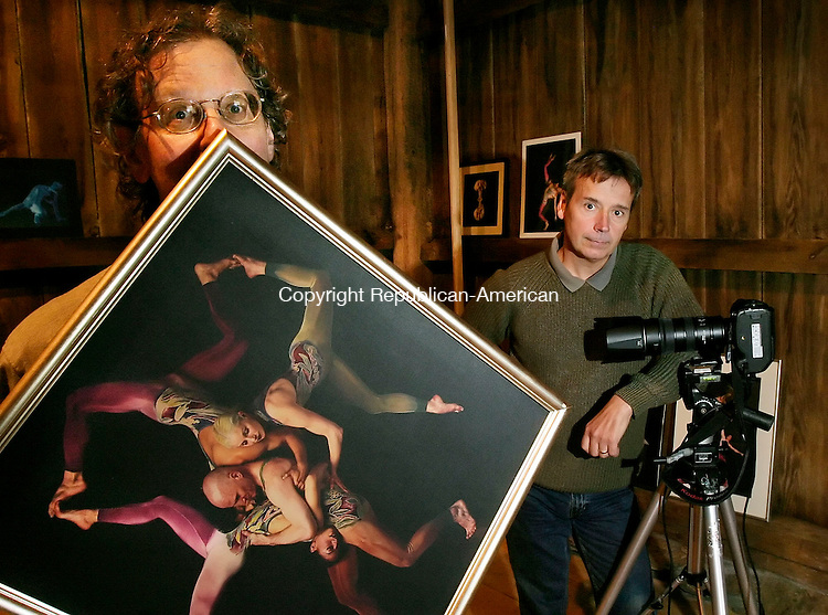 "NEW MILFORD, CT - 12 OCTOBER 2005 -101205JS04- Jonathan Wolken, Artistic Director and founding member of Pilobolus, left, holds a portrait of the dance group taken by New Milford photographer John Kane, right, for Kane's new book, ""The Human Alphabet"" which features 14 Pilobolus.   --Jim Shannon / Republican-American--Jonathan Wolken; Pilobolus, New Milford,  John Kane are CQ"