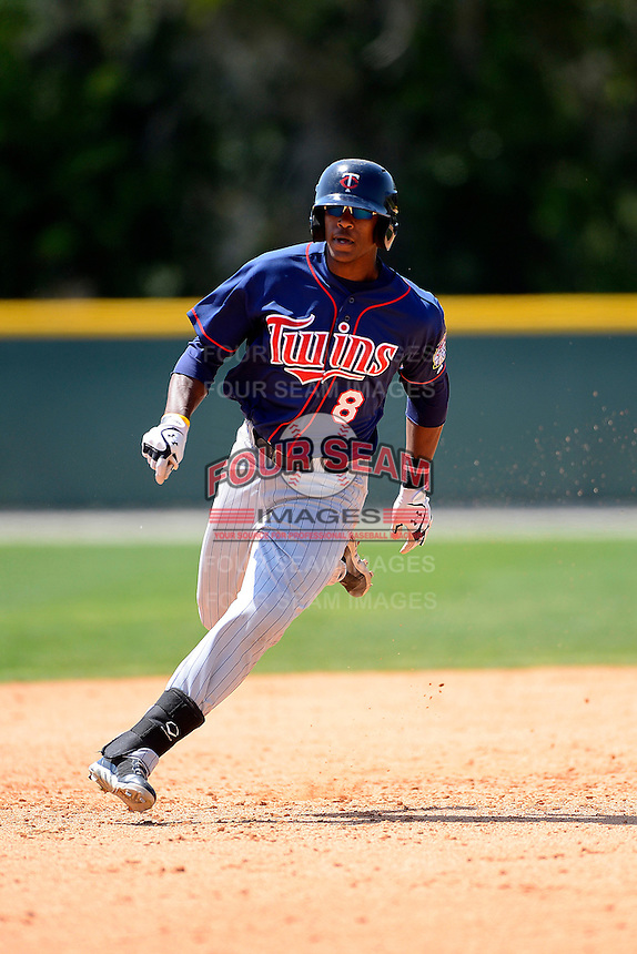 Minnesota Twins outfielder Adam Brett Walker #8 during a minor league Spring Training game against the Baltimore Orioles at Buck O'Neil Complex on March 26, 2013 in Sarasota, Florida.  (Mike Janes/Four Seam Images)