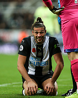 9th November 2019; St James Park, Newcastle, Tyne and Wear, England; English Premier League Football, Newcastle United versus AFC Bournemouth; Andy Carroll of Newcastle United grimaces after his is kicked in the head by Steve Cook of AFC Bournemouth  - Strictly Editorial Use Only. No use with unauthorized audio, video, data, fixture lists, club/league logos or 'live' services. Online in-match use limited to 120 images, no video emulation. No use in betting, games or single club/league/player publications