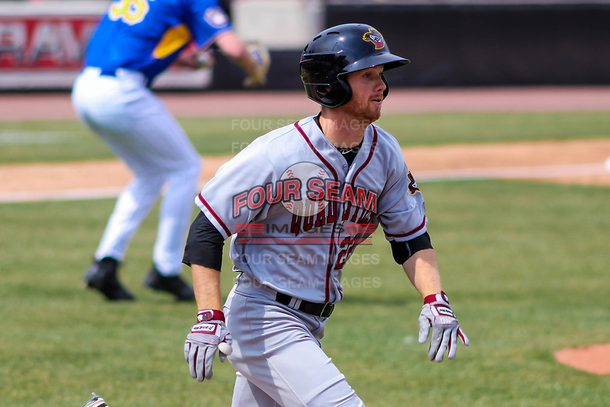 Quad Cities River Bandits outfielder Stephen Wrenn (22) runs to first base during a Midwest League game against the Wisconsin Timber Rattlers on April 9, 2017 at Fox Cities Stadium in Appleton, Wisconsin.  Quad Cities defeated Wisconsin 17-11. (Brad Krause/Four Seam Images)