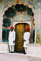 Turbaned guards stand to either side of the Peacock Gate to the inner courtyard, or Pitam Niwas Chowk at the Jaipur City Palace.